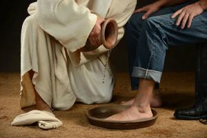 Jesus washing feet of modern man wearing jeans
